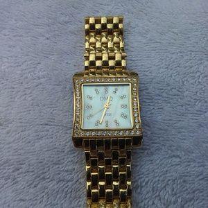DMQ gold watch